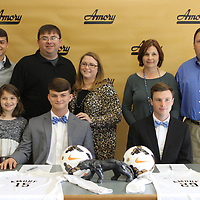 RAY VAN DUSEN/BUY AT PHOTOS.MONROECOUNTYJOURNAL.COM<br /> Front row, Matthew Martin, left, is surrounded by family members, Corbin, Ann Elise, Matt and Kelly Martin, and Ethan Gardner, right, is surrounded by his parents, Michael and Lisa Gardner.