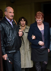 © Licensed to London News Pictures. 26/10/2011. London, UK. Janis Winehouse (second from left)  leaving St Pancras Coroners Court, London today (26/10/2011) following an inquest in to the death of singer Amy Winehouse.  A verdict of death by misadventure was recorded by the coroner. Photo credit: Ben Cawthra/LNP