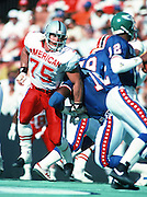 Los Angeles Raiders defensive end Howie Long (75) rushes the quarterback during the 1990 NFL Pro Bowl between the National Football Conference and the American Football Conference on Feb. 4, 1990 in Honolulu. The NFC won the game 27-21. (©Paul Anthony Spinelli)