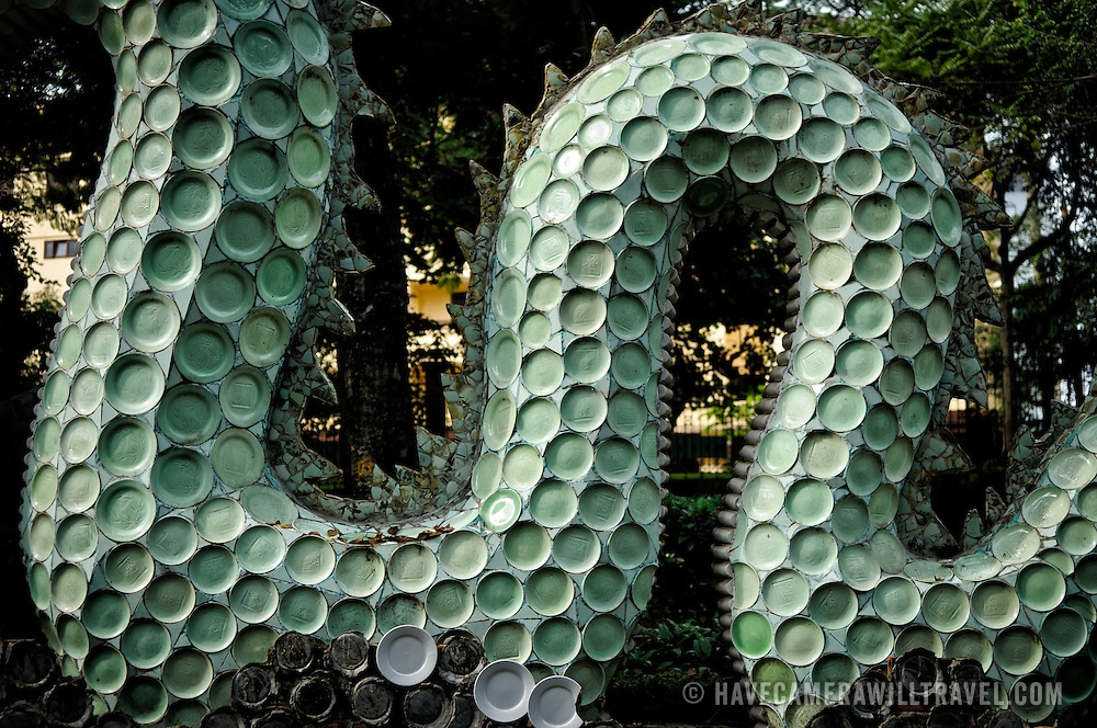 A large sculpture of a serpent dragon at the Hanoi Botanical Gardens (Vuon Bach Thao). The scales are made of porcelain plates.