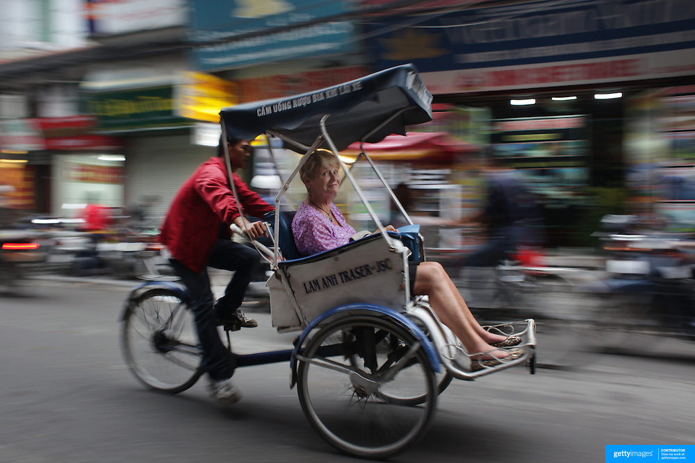 A tourist rides in a Bicycle Rickshaw or 'Cyclo' in the old quarter of Hanoi, Vietnam. Hanoi is the capital of Vietnam and the country's second largest city. Hanoi, Vietnam. 17th March 2012. Photo Tim Clayton