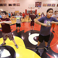 Adam Robison | BUT AT PHOTOS.DJOURNAL.COM<br /> Belmont Elementary Sixth graders Austin McGee and Erick Sanchez exercise with their classmates during the Move to Learn program lead by Coach Larry Calhoun Wednesday morning in Belmont.