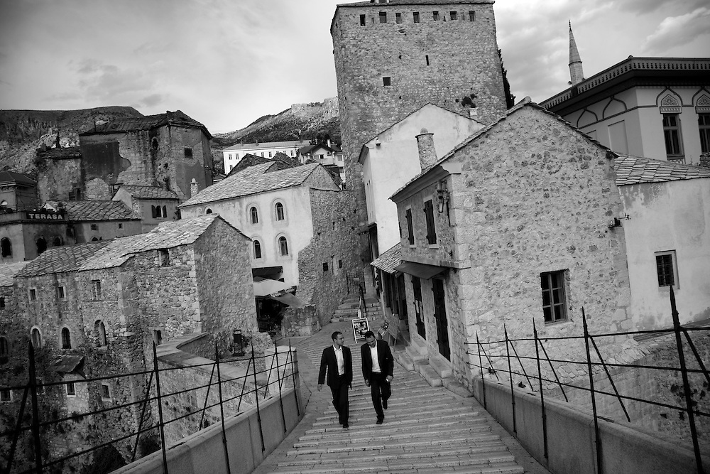 Walking over the rebuilt Old Bridge (Stari Most) in Mostar, Bosnia and Herzegovina.