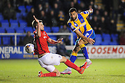 Kyle Vassell of Shrewsbury Town (on loan from Peterborough United) gets a shot in on goal despite the attentions of Réda Johnson of Coventry City FC during the Sky Bet League 1 match between Shrewsbury Town and Coventry City at Greenhous Meadow, Shrewsbury, England on 8 March 2016. Photo by Mike Sheridan.