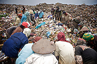 2009-03-13 Jakarta, Indonesia. Kedawung Wetan village in the Tangerang district next to the airport of Jakarta is one of the poorest areas of Jakarta. It&rsquo;s famous for Rawa Kucing, the huge garbage dump. Many adults and children work at the waste site sifting through the rubbish to collect recyclable materials like plastic bags. <br />