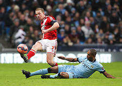 Middlesbrough's Grant Leadbitter is fouled by Manchester City's Fernandinho - Photo mandatory by-line: Matt McNulty/JMP - Mobile: 07966 386802 - 24/01/2015 - SPORT - Football - Manchester - Etihad Stadium - Manchester City v Middlesbrough - FA Cup Fourth Round