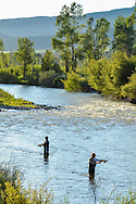Alan Coleman, foreground, and his son Chris enjoy fly fishing in the Roaring Fork River near the bridge on County Road 100, just outside of Carbondale, Colorado.