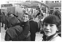 Group of kids on a market, London street photography in 1982. Tri-X