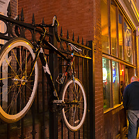 A locked up bicycle is seen chained to a fence on Music Row in downtown Nashville, Tennessee on Friday, November 13, 2015. (Alex Menendez via AP)