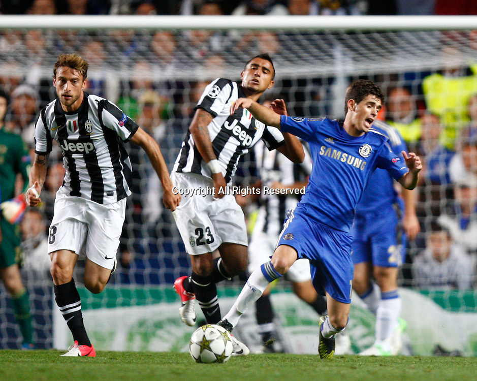 19.09.12 London, ENGLAND: <br /> Oscar of Chelsea and Arturo Vidal of Juventus F.C.<br /> during the UEFA Champions League Group E match between Chelsea and  Juventus at Stamford Bridge Stadium