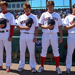 March 12, 2011; Fort Myers, FL, USA;  Boston Red Sox players (from left to right) Hideki Okajima, Daisuke Matsuzaka, Itsuki Shoda, and Junichi Tazawa stand during a moment of silence for quake and tsunami victims in Japan before a spring training exhibition game against the Florida Marlins at City of Palms Park. The Red Sox defeated the Marlins 9-2.  Mandatory Credit: Derick E. Hingle
