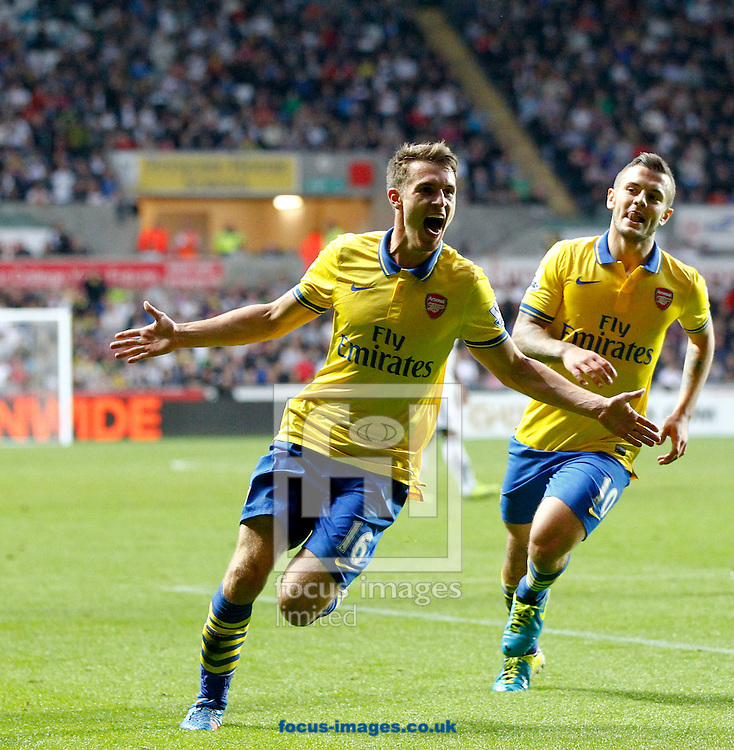 Picture by Mike  Griffiths/Focus Images Ltd +44 7766 223933<br /> 28/09/2013<br /> Aaron Ramsey (L) and Jack Wilshere (R) of Arsenal celebrates the second goal during the Barclays Premier League match at the Liberty Stadium, Swansea.