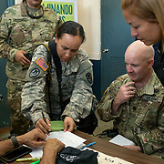 OCTOBER 20 - SANTA ISABEL, PUERTO RICO - <br /> Santa Isabel mayor Enrique Questell Alvarado, left,  and 105th Engineer Battalion Lt. Coronel Cale Moody, go over maps showing areas the town needs help from the US Military in. Municipal employee Ricky Burgos, middle, is translating.  SGT Lauren Hawkins writes a note.<br /> (Photo by Angel Valentin/Freelance)
