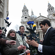 The funeral of former Prime Minister Margaret Thatcher who died Monday April 8. A man is handing out blue roses, the color of consevatism to mourners outside ST Paul's