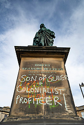 Edinburgh, Scotland, UK. 12 June 2020. Black lives matter protestors have sprayed graffiti on statue of Robert Viscount Melville, son of slave owner Henry Dundas, in Edinburgh. This is one of many colonial era statues of former slavers that are under threat by protestors who want them taken down.  Iain Masterton/Alamy Live News
