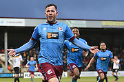 Scunthorpe United striker Tom Hopper (14) celebrates scoring goal to go 3-2 up with Scunthorpe United forward Ivan Toney (24) and Scunthorpe United midfielder Duane Holmes (19) behind him during the EFL Sky Bet League 1 match between Scunthorpe United and Port Vale at Glanford Park, Scunthorpe, England on 28 January 2017. Photo by Ian Lyall.