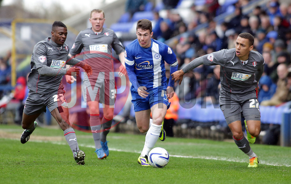 Peterborough United's Tommy Rowe gets away from Rotherham United's James Tavernier, Nicky Adams and Kieran Agard - Photo mandatory by-line: Joe Dent/JMP - Mobile: 07966 386802 22/03/2014 - SPORT - FOOTBALL - Peterborough - London Road Stadium - Peterborough United v Rotherham United - Sky Bet League One