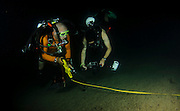 professional Scuba divers perform an underwater survey of the Mediterranean seabed