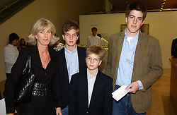 Left to right, MRS CHRISTOPHER MILLS with her sons NICHOLAS MILLS, HARRY MILLS (front) and CHARLIE MILLS at the Depal Trust 2in1 Art Party at The National Portrait Gallery, London on 25th October 2004.<br />