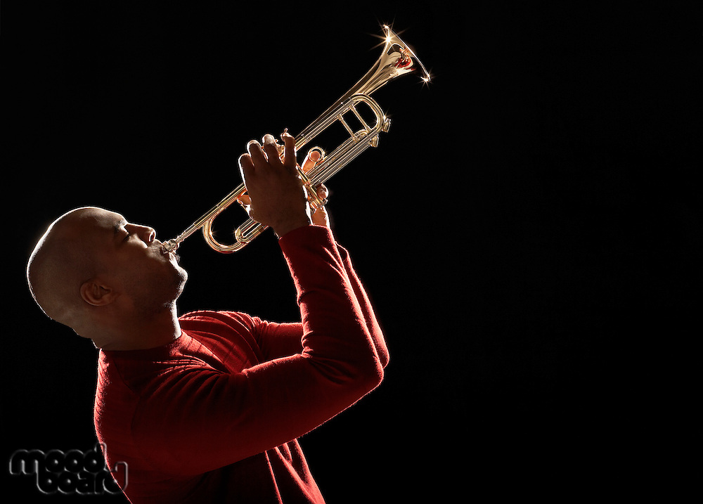 Man Playing Trumpet side view close-up