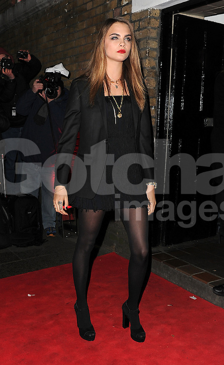 Model Cara Delevingne attends the YSL Beauty: YSL Loves Your Lips party at The Boiler House,The Old Truman Brewer in London, UK. 20/01/2015<br /> BYLINE MUST READ : GOTCHAIMAGES.COM<br /> <br /> Copyright by &copy; Gotcha Images Ltd. All rights reserved.<br /> Usage of this image is conditional upon the acceptance <br /> of Gotcha Images Ltd, terms and conditions available at<br /> www.gotchaimages.com