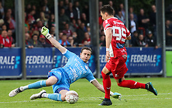 April 28, 2018 - Mouscron, BELGIUM - Essevee's goalkeeper Sammy Bossut and Mouscron's Dorin Rotariu fight for the ball during a soccer game between Royal Excel Mouscron and Zulte Waregem, in Mouscron, Saturday 28 April 2018, on day six of the Play-Off 2A of the Belgian soccer championship. BELGA PHOTO VIRGINIE LEFOUR (Credit Image: © Virginie Lefour/Belga via ZUMA Press)