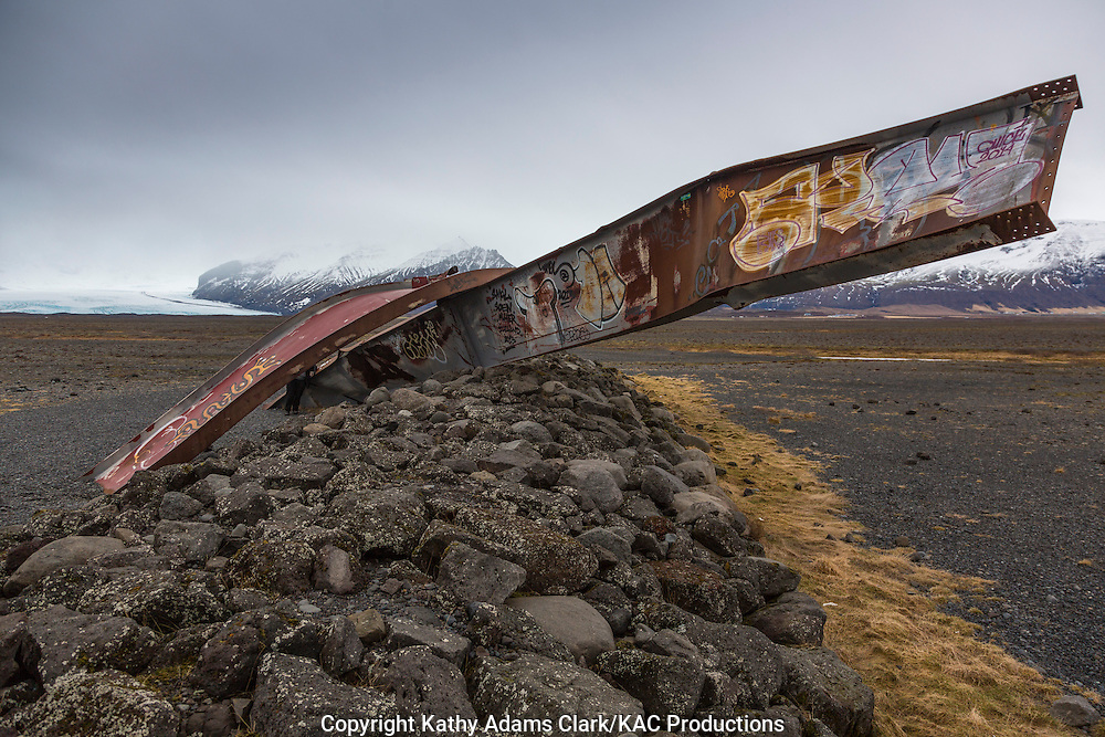 Gigjukvisl Bridge, damaged by a glacial flood in 1996 after the Grimsvotn volcano exploded in the Vatnajokull glacier in Iceland  Part of the bridge stands as a roadside display.