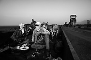 Zouarete, Mauritania -  24 January, 2016:<br /> Passengers in the train full of Iron, after leaving the mining town Zouarete in the middle of the Sahara desert.