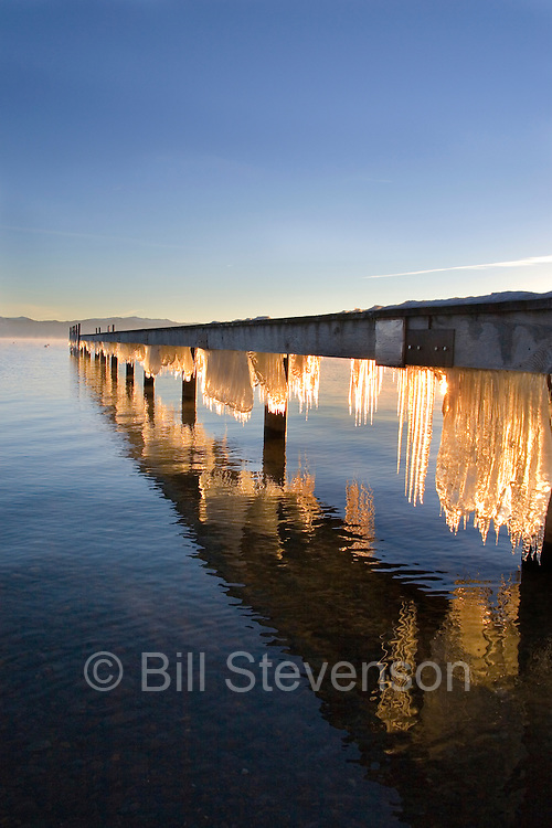 A photo of Icicles beneath a dock on Lake Tahoe in California at sunrise.