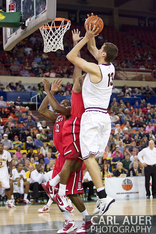 November 27th, 2010:  Anchorage, Alaska - Arizona State's Jordan Bachynski (13) goes to the hoop strong in the Sun Devil's 58-67 loss to St. Johns in the championship game of the Great Alaska Shootout.