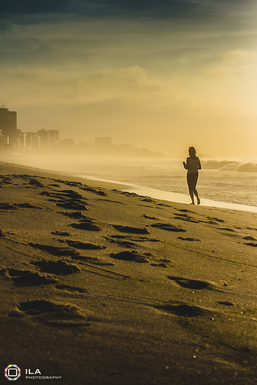 A woman walking at Leblon beach during the early hours of the morning. Rio de Janeiro, Brazil.<br /> <br /> ••• Thank you for your &quot;Views&quot;,&quot;Faves&quot; and/or &quot;Comments&quot; - they are always welcomed! Feel free to ask any questions as well :)<br />  <br /> •∆• Press &quot;L&quot; to view it in large on black &amp; &quot;F&quot; to favourite it •••<br />  <br /> •∆• Instagram: @camila_clarke •∆•