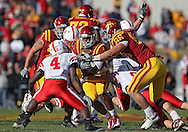 November 06 2010: Iowa State Cyclones quarterback Austen Arnaud (4) is hit by Nebraska defenders on a run during the first half of the NCAA football game between the Nebraska Cornhuskers and the Iowa State Cyclones at Jack Trice Stadium in Ames, Iowa on Saturday November 6, 2010. Nebraska defeated Iowa State 31-30.