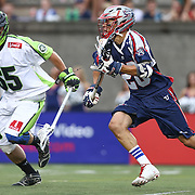Owen Blye #20 of the Boston Cannons tries to run past Mike Unterstein #65 of the New York Lizards during the game at Harvard Stadium on July 19, 2014 in Boston, Massachusetts. (Photo by Elan Kawesch)