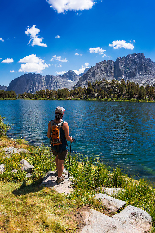 hiker on the shore of Big Pine Lake #6, John Muir Wilderness, Sierra Nevada Mountains, California USA