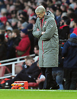Football - 2016 / 2017 Premier League - Arsenal vs. Burnley<br /> <br /> Arsenal Manager Arsene Wenger kicks over the water bottles and is subsequently sent to the stands by Referee Jon Moss after also arguing with the 4th official at The Emirates.<br /> <br /> COLORSPORT/ANDREW COWIE