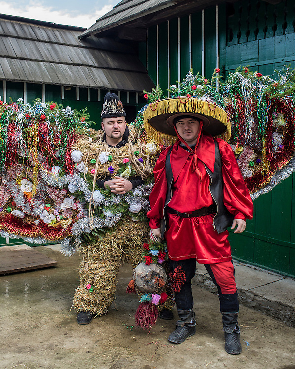 "Stepan Savchuk, 26, left, wearing an elaborate bear costume, and Ivan Herman, 27, dressed as a gypsy, costumes that will be worn as part of celebrations in the Trazhan district during the Malanka Festival on Wednesday, January 13, 2016 in Krasnoilsk, Ukraine. The festival begins at sundown and will last until the following evening. Herman says: ""I've been working in Spain for eight years, but I come back every year for Malanka."""