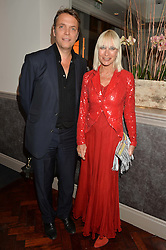 MIKE SIMCOCK and VIRGINIA BATES at a dinner to celebrate 20 years of Maria Grachvogel's fashion label held at Salmontini, 1 Pont Street, London on 22nd October 2014.