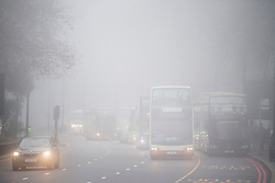 © Licensed to London News Pictures. 17/12/2016. London, UK. Buses and cars make their way through thick fog in Park Lane. Parts of the UK are swathed in thick fog this morning. Photo credit: Ben Cawthra/LNP