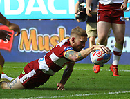 Sam Tomkins of Wigan Warriors dives to score the try against Warrington  Wolves during the Betfred Super League match   at the Dacia Magic Weekend, St. James's Park, Newcastle<br /> Picture by Stephen Gaunt/Focus Images Ltd +447904 833202<br /> 19/05/2018