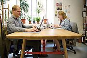 Furniture designer Leonhard Pfeifer's Hackney studio, London. David Broad (left) and Karla Thompson (right) wokring on the Affoltern dining table, Manufactured by Romania producer DoroBanti<br /> CREDIT: Vanessa Berberian for The Wall Street Journal<br /> GURU-Pfeifer
