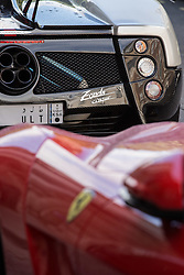 © Licensed to London News Pictures. 27/07/2015. London, UK. A Pagani Zonda and Ferrari seen near Park Lane in London. Kensington and Chelsea Borough Council have announced plans that will make it a criminal offence to cause excessive noise unnecessarily, which will aim to stop showboating by drivers revving their engines, or super-fast accelerating. Photo credit : James Gourley/LNP