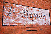Antique sign on the historic Exon Mercantile building, Dolores, Colorado
