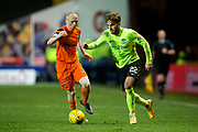 Hibernian midfielder Andrew Shinnie (#22) takes on Dundee United midfielder Willo Flood (#16) during the Ladbrokes Scottish Championship match between Dundee United and Hibernian at Tannadice Park, Dundee, Scotland on 10 March 2017. Photo by Craig Doyle.