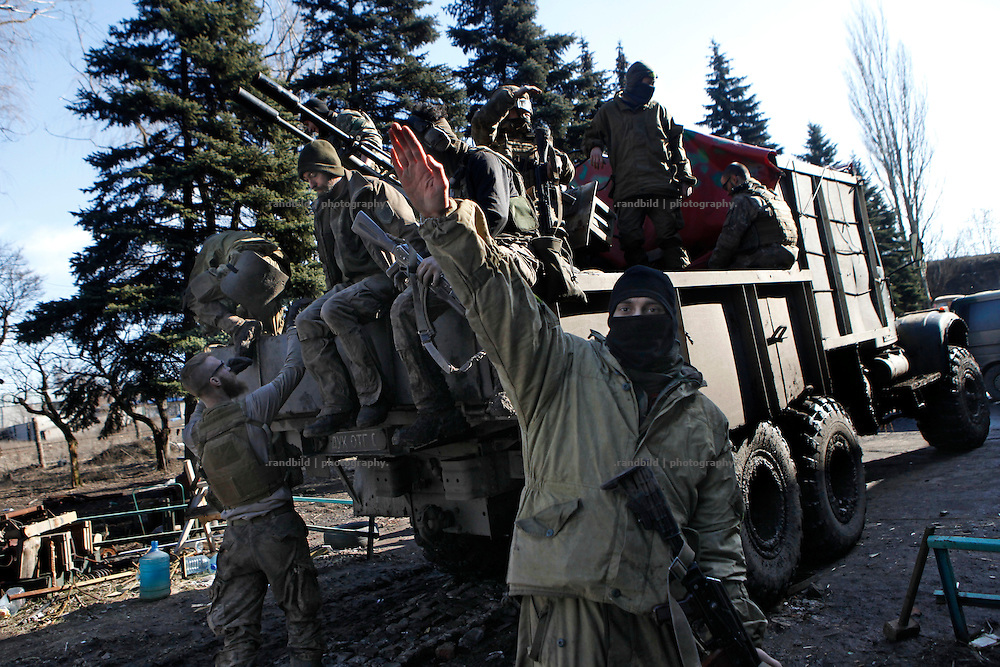 A member of the right-wing militia makes a Hitler salute when returning from the Donetsk frontline.<br />