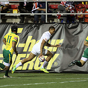 England's Dan Norton breaks to the sideline for a second half try vs Brazil.  Photo by Barry Markowitz, 2/10/12