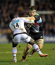 Jack Clifford of Harlequins looks to fend Christian Wade of Wasps - Photo mandatory by-line: Patrick Khachfe/JMP - Mobile: 07966 386802 17/01/2015 - SPORT - RUGBY UNION - London - The Twickenham Stoop - Harlequins v Wasps - European Rugby Champions Cup