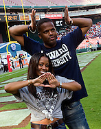 Keshia Knight Pulliam, left, and AJ Calloway, right emcees for the Target half-time show, wave to fans during the AT&T Nation's Classic Football game with Howard University and Morehouse College. Howard won the game  30-27 at RFK Stadium in Washington, DC  (Alan Lessig)Alan Lessig Photography.http://lessigphotography.photoshelter.com/
