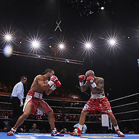 Keith Thurman (L) and Luis Collazo fight during their Premier Boxing Champions boxing match for the WBA Welterweight title on ESPN at the USF Sun Dome, on Saturday, July 11, 2015 in Tampa, Florida.  Thurman won the bout when the corner of Collazo stopped the fight at the beginning of the eighth round. (AP Photo/Alex Menendez)