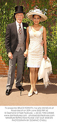 TV presenter BRUCE FORSYTH, his wife WILNELIA at Royal Ascot on 20th June 2002.	PBF 62
