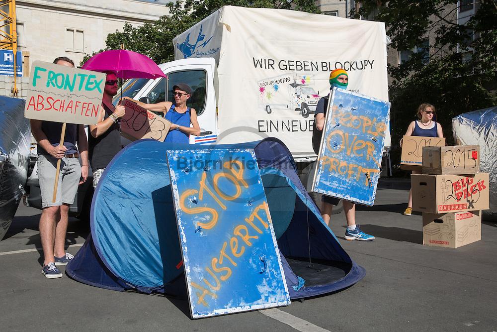 Berlin, Germany - 22.07.2016<br /> <br /> Protest at the Federal Ministry of Labour and Social Affairs in advance of the September protests of Blockupy-movement in Berlin. The larger Blockupy protests were directed in the past against the ECB in Frankfurt. With a float the protest now been symbolically move from Frankfurt to Berlin. As part of the action and the street are sprayed in the ministry with slogans.<br /> <br /> Protestaktion am  Bundesministeriums f&uuml;r Arbeit und Soziales im Vorfeld der f&uuml;r September angekuendigten Proteste des Blockupy-Buendnisses in Berlin. Die groe&szlig;eren Blockupy-Proteste richteten sich in der Vergangenheit gegen die EZB in Frankfurt am Main. Mit einem Umzugswagen wurde der Protest nun symbolisch von Frankfurt nach Berlin gebracht. Im Rahmen der Aktion wurden auch die Stra&szlig;e vor dem Ministerium mit Parolen besprueht.<br /> <br /> Photo: Bjoern Kietzmann